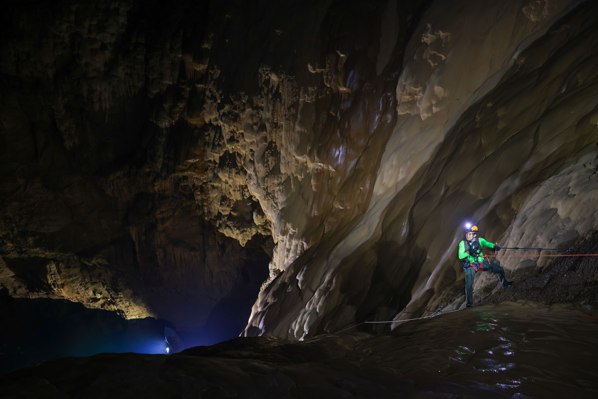 Visitors climb down during a tour in Son Doong cave, one of the world's largest natural caves, in central Vietnam's Quang Binh province on January 19, 2021.  Photo by Ngo Tran Hai An.